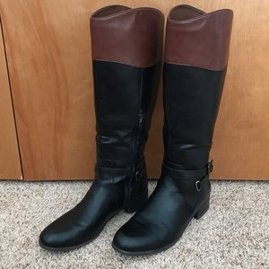 Brown and black riding boots